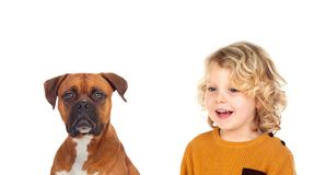 Funny blond child and his dog stock photo