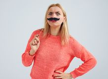 Funny blond with fake moustache. Isolated on white Royalty Free Stock Photography