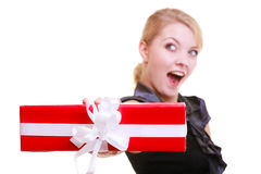Funny blond girl in black dress holding red christmas gift box. Holiday. Royalty Free Stock Image