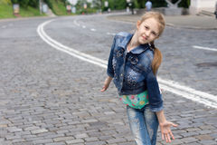 Funny blond girl posing as a top model outdoors Royalty Free Stock Photo