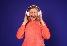 Funny blond in headphones. Studio shot Royalty Free Stock Photo