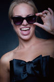 Funny blond wearing sun glasses Royalty Free Stock Photos