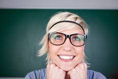 Funny Blond Woman Laughing Against Chalkboard Stock Image