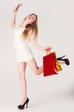 Funny blond woman with shopping bags Royalty Free Stock Image