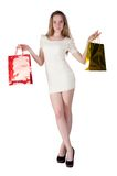 Funny blond woman with shopping bags Stock Photo