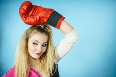 Funny girl in red gloves playing sports boxing stock image