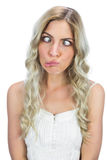 Funny blonde squinting while posing Stock Image