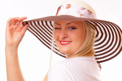 Funny blonde woman in a hat Stock Photography