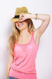 Funny blonde woman with straw hat isolated on white Royalty Free Stock Photo