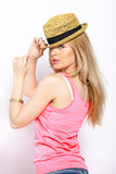 Funny blonde woman with straw hat isolated on white Royalty Free Stock Photography