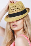 Funny blonde woman with straw hat isolated on white Stock Images
