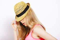Funny blonde woman with straw hat isolated on white Royalty Free Stock Images