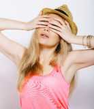 Funny blonde woman with straw hat isolated on white Stock Photo