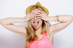 Funny blonde woman with straw hat isolated on white Royalty Free Stock Photos