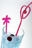 Funny blue cocktail. Blue cocktail with cherry and ice and red heart royalty free stock photography
