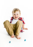 Funny blue-eyed three-year boy. Studio photo Royalty Free Stock Image