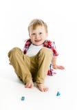 Funny blue-eyed three-year boy. Studio photo. Funny blue-eyed three-year boy on a light background. Studio photo Royalty Free Stock Image
