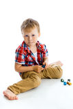 Funny blue-eyed three-year boy. Studio photo Stock Images
