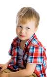 Funny blue-eyed three-year boy on a white background. Studio photo Stock Image