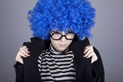 Funny blue-hair girl in glasses and black coat. Stock Images