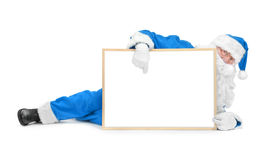 Funny blue santa and empty white board Stock Images