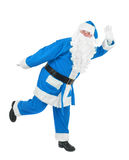 Funny blue santa waves hand Royalty Free Stock Image