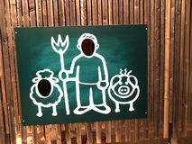 Funny board with shapes of man, pig and sheep Royalty Free Stock Photo