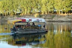Funny boat on dnistro river moldavia Stock Photo