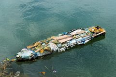 Funny Boat made ​​of garbage. Stock Images