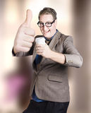 Funny boss giving big thumb up with coffee cup Stock Image