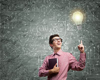 Funny botanist. Young funny man in glasses against chalkboard with sketches Stock Photos