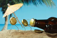 Funny bottle cork on  sandy beach Royalty Free Stock Photos