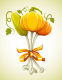 Funny bouquet made of halloween pumpkins on bones Royalty Free Stock Photography