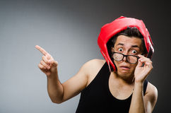 Funny boxer with red gloves against Stock Photography