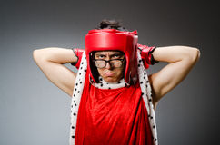 Funny boxer with red gloves against Royalty Free Stock Photo