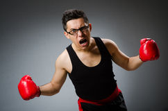 Funny boxer with red gloves against Royalty Free Stock Images