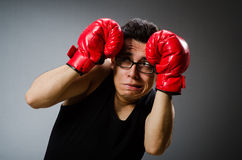 Funny boxer with red gloves against Stock Images
