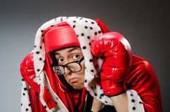 Funny boxer with red gloves against Stock Photo