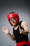 Funny boxer with red gloves against Stock Photos