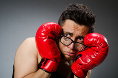 Funny boxer with red gloves against Royalty Free Stock Photos