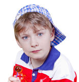 Funny boy. The little boy with a cap and candy on white background Stock Photos