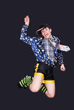 Funny boy. Comical teenager jumping, funny clothing, people diversity Royalty Free Stock Photography