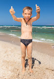 Funny boy on the beach Stock Photography