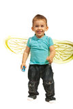 Funny boy with bee wings. Funny little boy with bee wings taking tongue out Royalty Free Stock Images