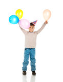 Funny boy in birthday cap royalty free stock photography