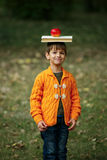Funny boy with book on his head Stock Photo
