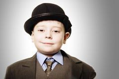 Funny boy in bowler hat Stock Photos