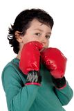 Funny boy with boxing gloves royalty free stock photography