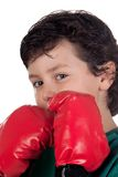 Funny boy with boxing gloves Royalty Free Stock Image