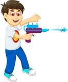 Funny boy cartoon playing water gun Royalty Free Stock Photo
